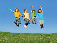 Happy children jumping in the air together